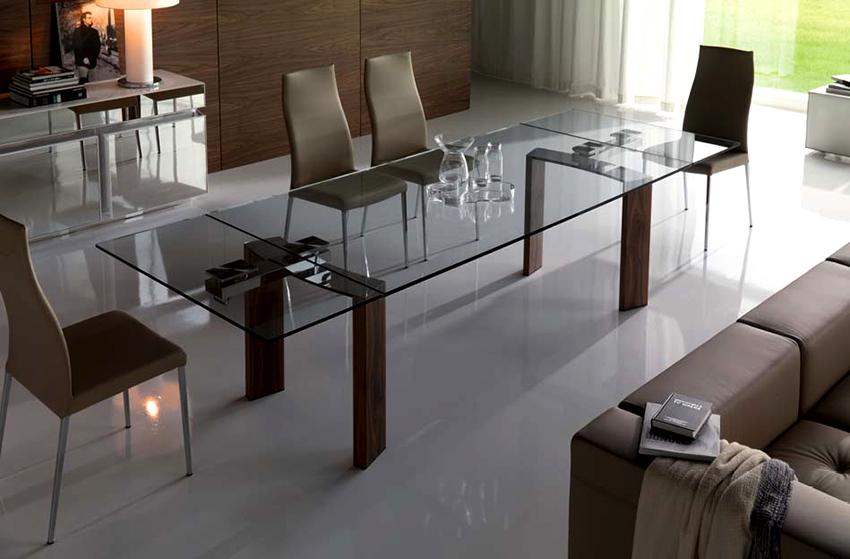 Раздвижные стеклянные столы хорошо смотрятся в разных стилях интерьеров