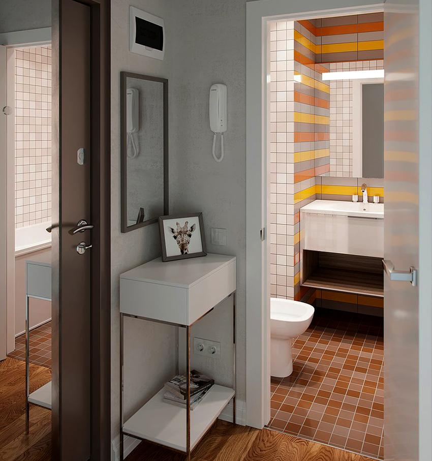 Зеркало на входной двери способно зрительно увеличить пространство и добавить освещенности помещению
