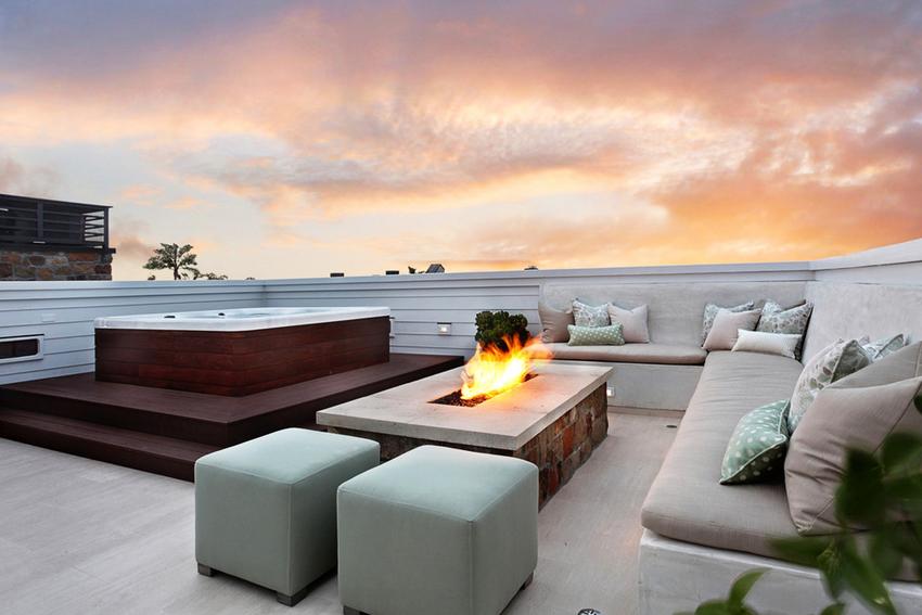 На плоской крыше можно устроить террасу, бассейн, зону для барбекю