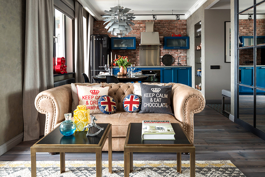 Делить пространство гостиной на зоны можно с помощью цвета или мебели