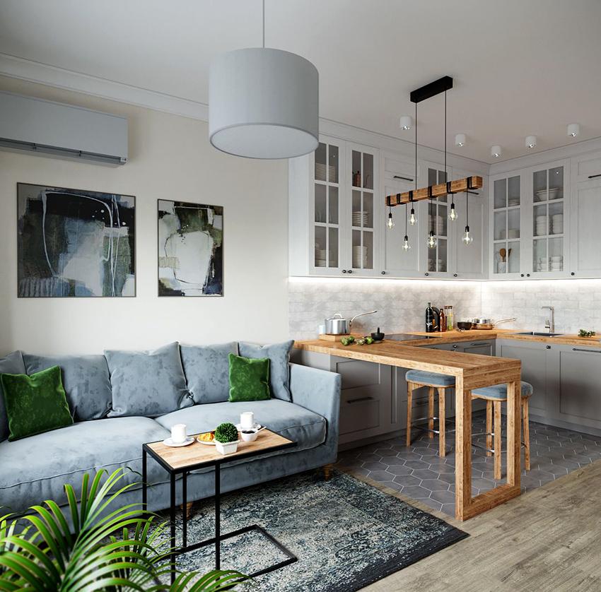 Кухня, совмещенная с гостиной – распространенное решение в скандинавском интерьере