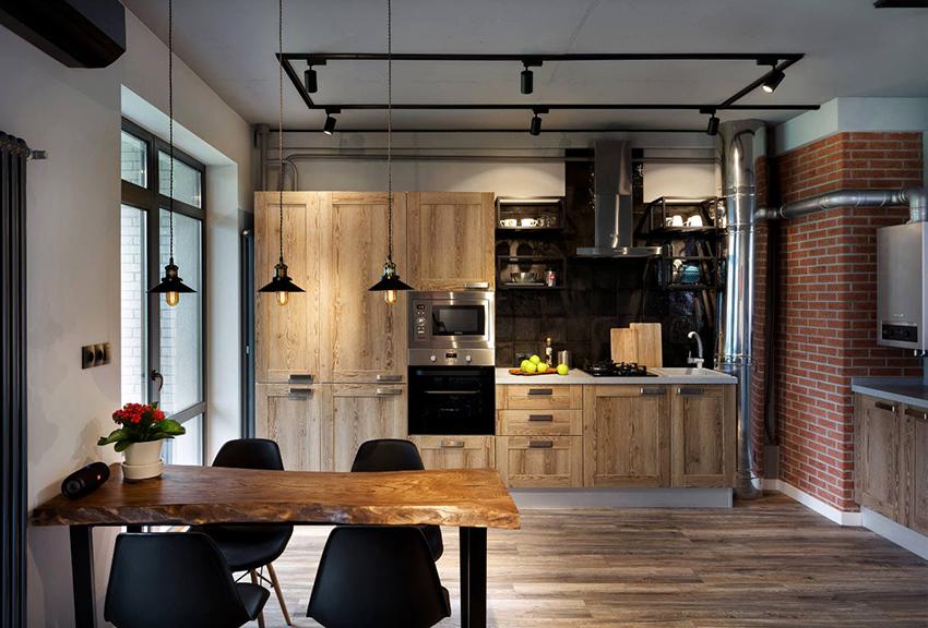 Для кухни в стиле лофт характерно, когда фасады мебели контрастируют со стенами