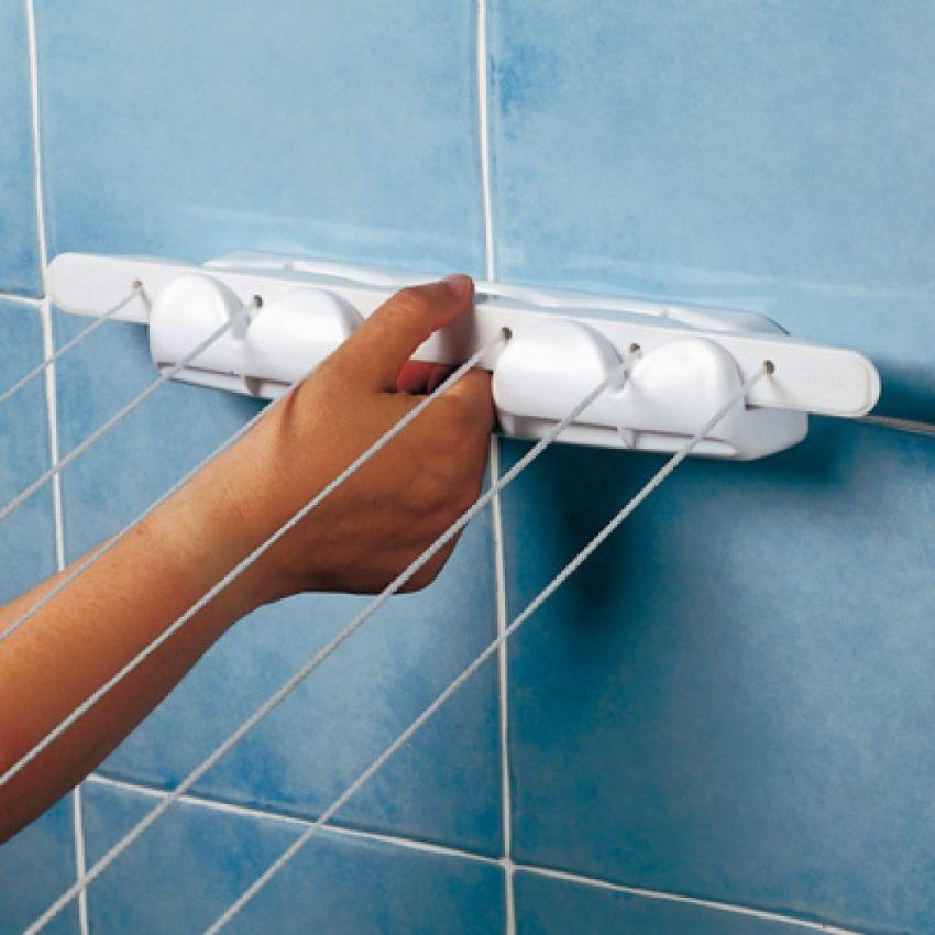 Настенная сушилка фиксируется к стене с помощью анкеров или металлических шурупов