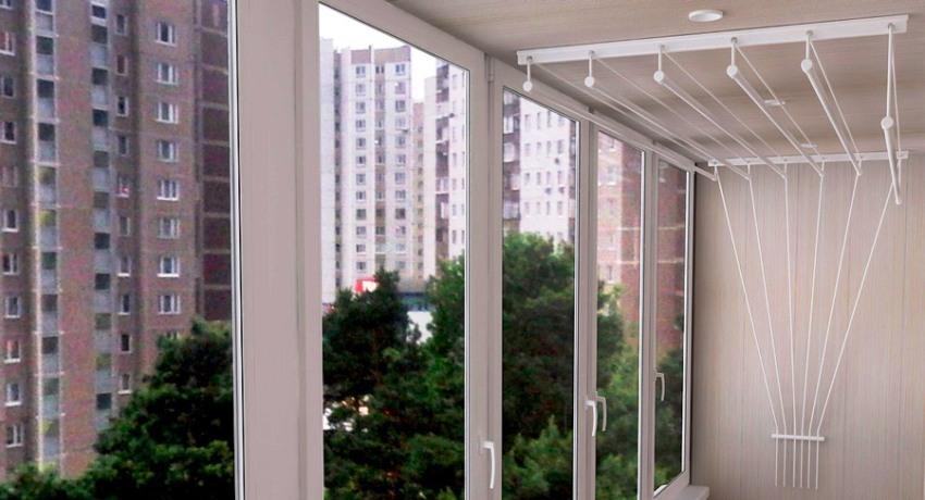 Потолочная сушилка для белья на балкон: преимущества перед другими моделями подробно, с фото