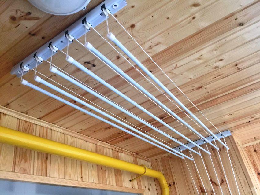 В конце процесса нужно обязательно проверить качество монтажа потолочной сушилки