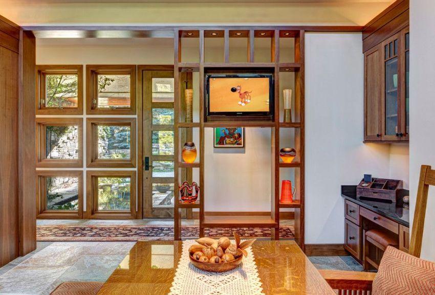 Предпочтительно выбирать стеллажи, которые выглядят презентабельно и впишутся в общий дизайн комнаты