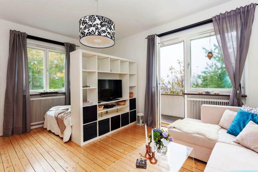 Стеллаж в гостиную предназначен для мультимедийной аппаратуры и хранения предметов первой необходимости