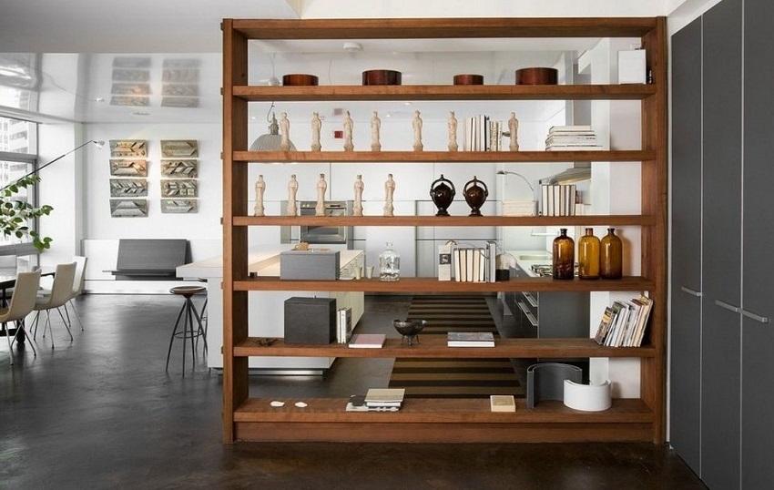 С помощью стеллажей можно красиво и оригинально осуществить зонирование помещений