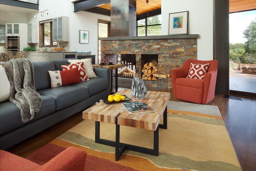 Стиль фьюжн прекрасно подходит для открытой планировки гостиной, так как с его помощью легко зонировать пространство