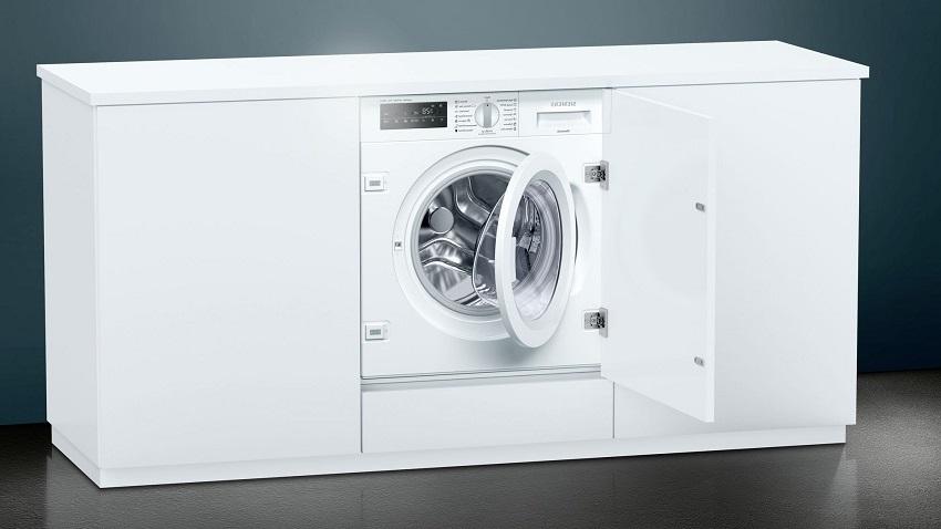 Встраиваемая стиральная машина Сименс WI 14 W 540 имеет скорость отжима 1400 об/мин