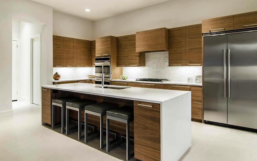Кухонная утварь прячется за фасадом корпусной мебели в стиле минимализм