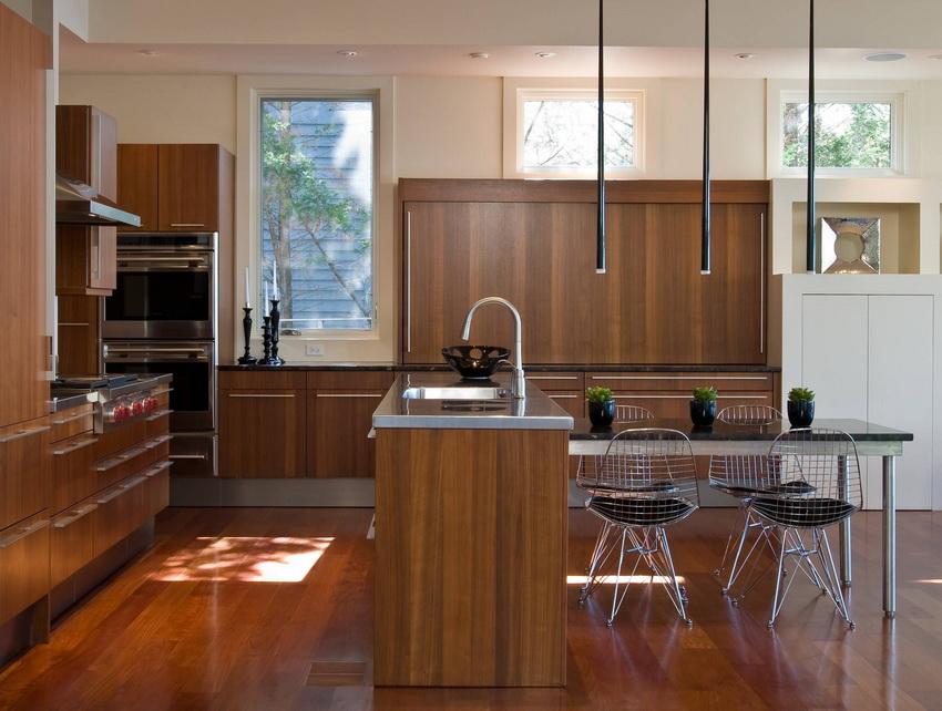 Угловой кухонный гарнитур в стиле модерн как нельзя лучше подходит для помещений с открытой планировкой