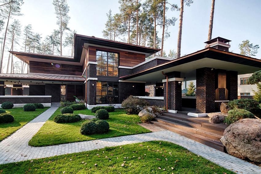 Двухэтажный кирпичный дом – оптимальны вариант для небольших земельных участков
