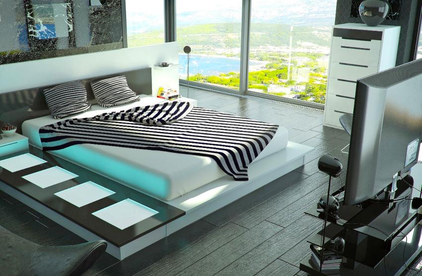 Возле кровати можно установить массивную напольную вазу или необычный светильник