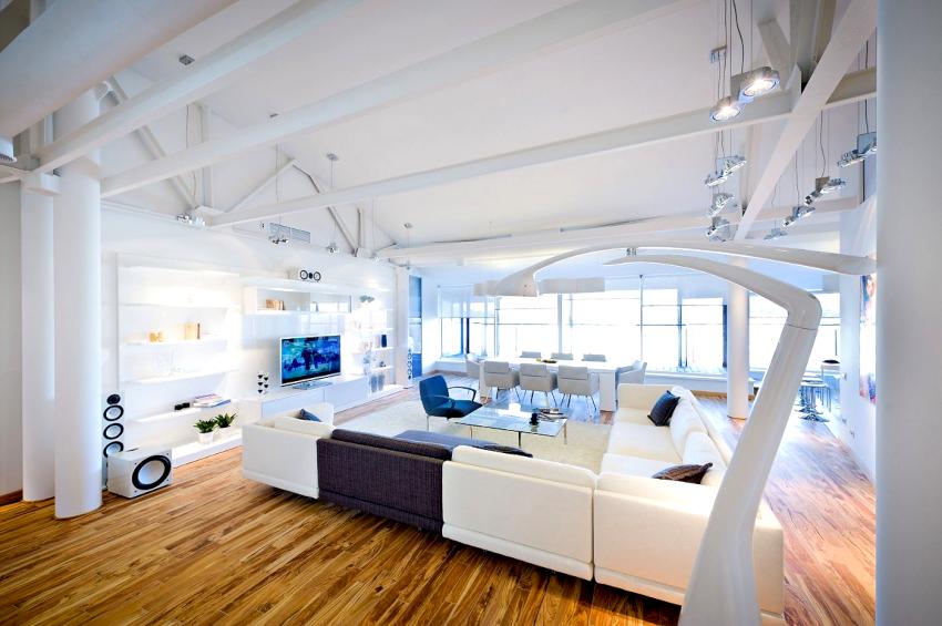 Мебель в гостиной хай-тек должна иметь светлые оттенки и ламинированные поверхности