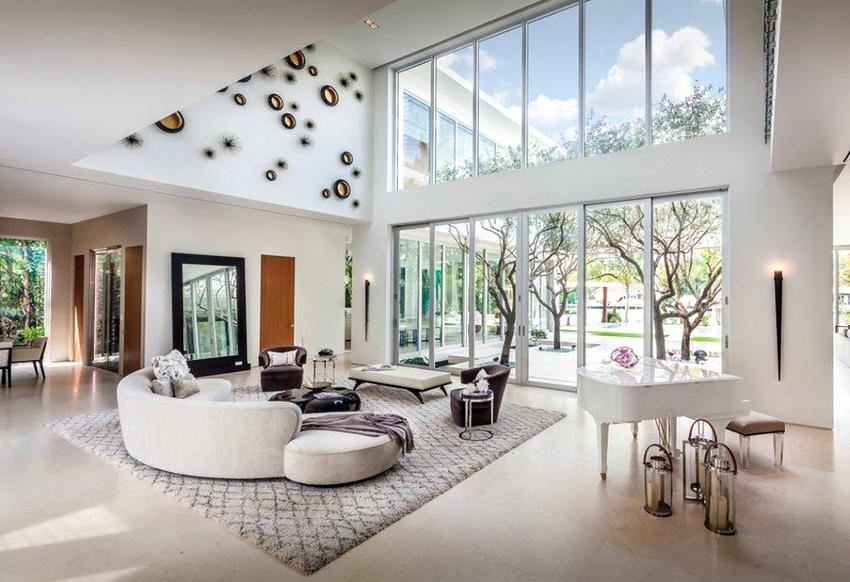 В гостиной модерн неприемлемо применение большого количества текстиля и декора