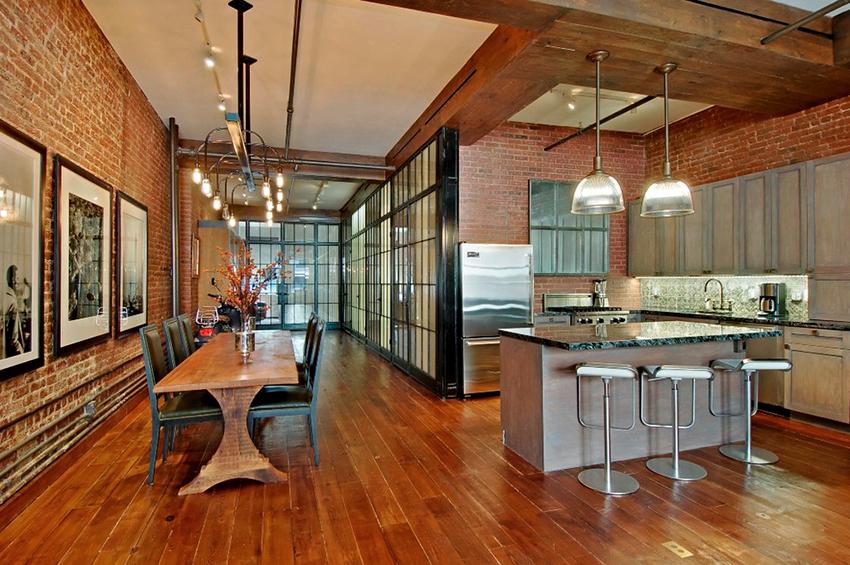 В квартирах и домах лофт стиля кухня объединяется с обеденной зоной