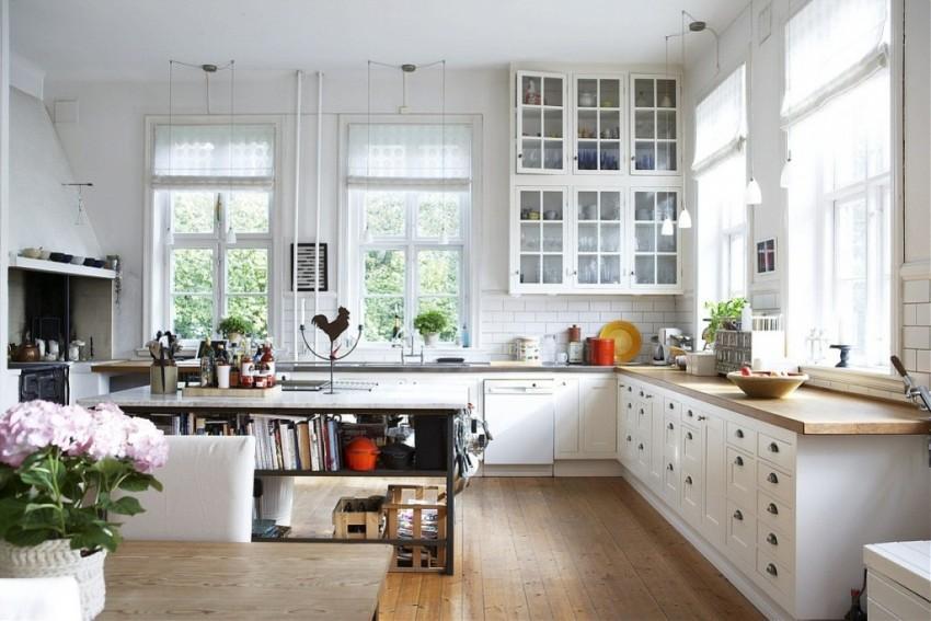 В интерьере кухни стиль прованс реализуется в мебели из натуральной древесины