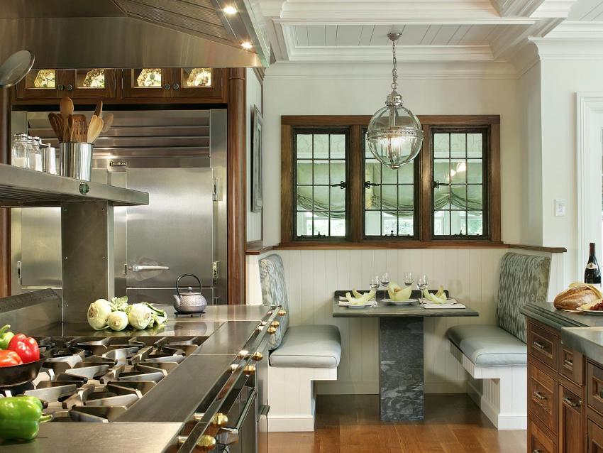 Кухонный уголок служит прекрасным разграничителем обеденной зоны от зоны приготовления пищи