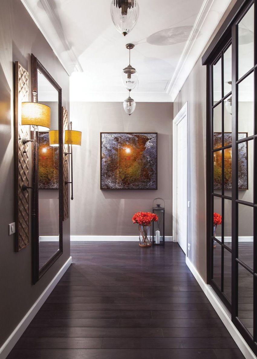 Sliding wardrobes with mirrors will help to expand the space in a small corridor