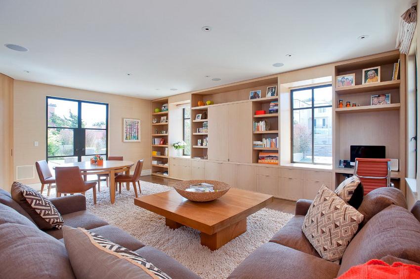 Современные стенки в гостиную делятся на два типа: модульные или сборные конструкции и цельные сплошные