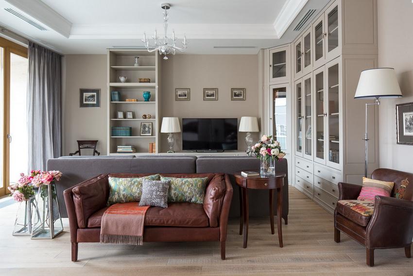 Угловая стенка способна замаскировать недостатки помещения, а также обеспечить максимальное удобство хранения вещей