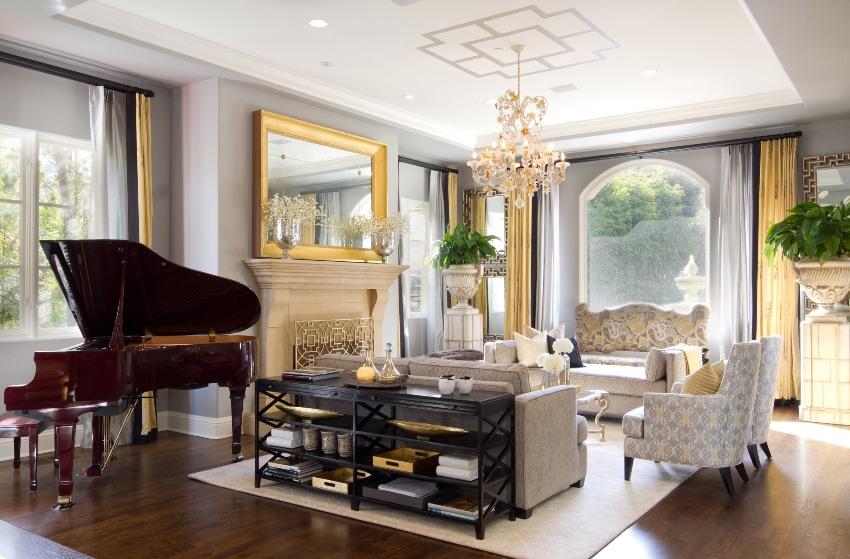 Одним из часто встречающихся вариантов зонирования гостиной является стол либо журнальный столик, вокруг которого распределены места для сидения