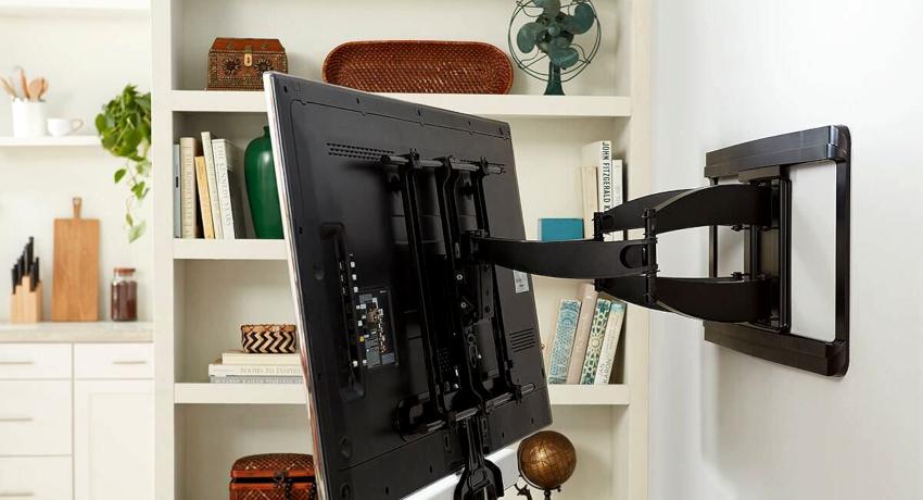 Как повестить телевизор на стену: советы по проведению грамотного монтажа