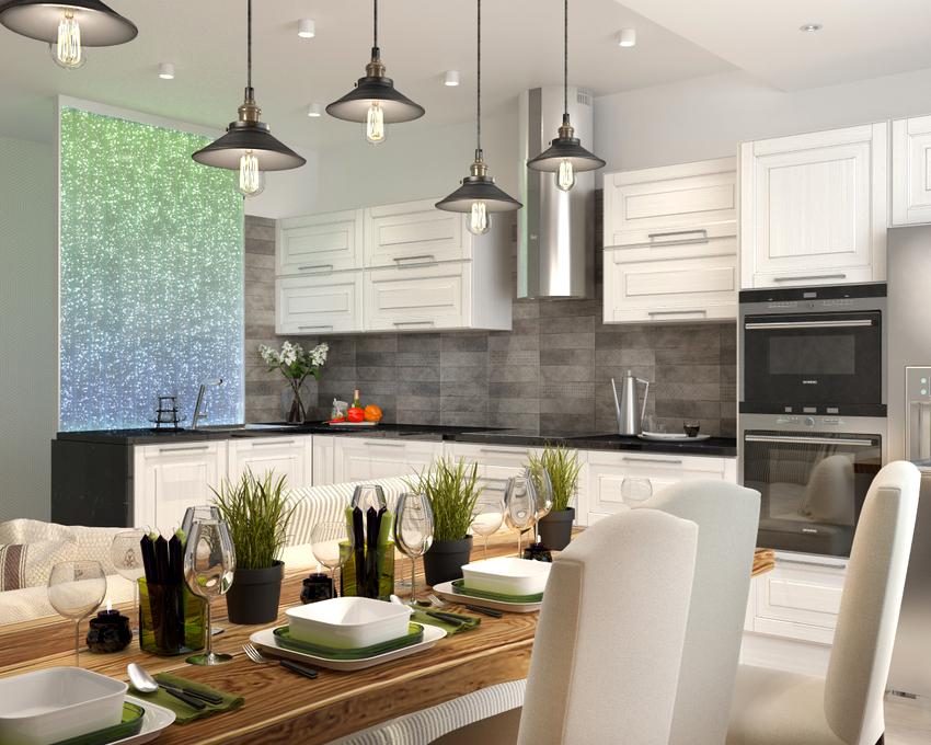 В случае применения подвесного варианта освещения на кухне над столом лучше отдавать предпочтение моделям, у которых регулируется длина подвеса