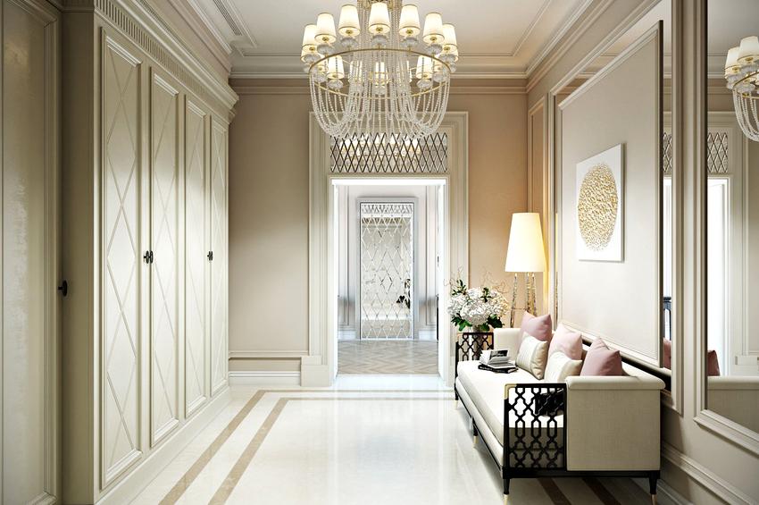 Стиль прихожей со встроенным гардеробом напрямую определяется дизайном фасада мебели