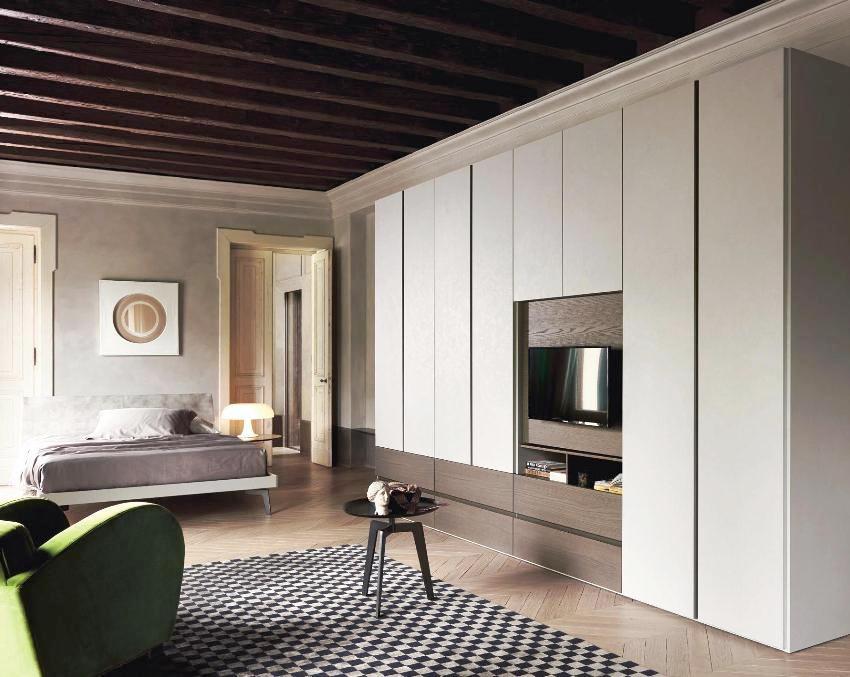 Прямые линии и однотонные фасады - это основа стенок в стиле минимализм