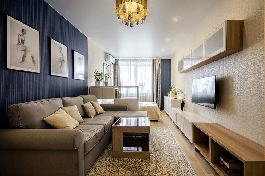 Угловой диван станет идеальным решении для гостиной совмещенной со спальней