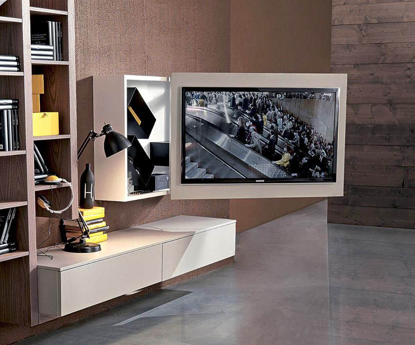 Монтаж телевизора с помощью кронштейна возможен как на стену, так и на мебель