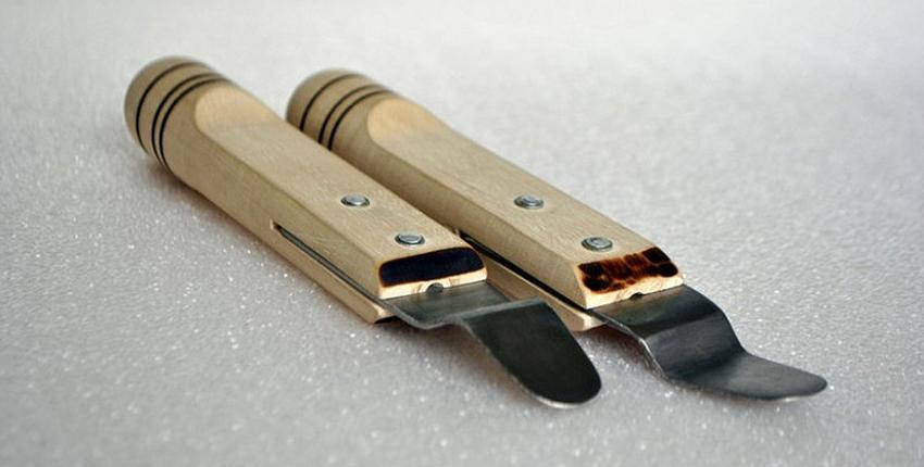 Основными инструментами для закрепления натяжного потолка являются лопатки для внедрения полотна в профили
