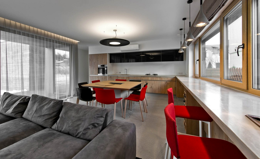 Подбирая материал для стола вместо подоконника, лучше отдать предпочтение граниту или композитному материалу
