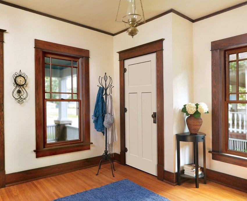 Использование в интерьере контрастного сочетания дверей и наличников
